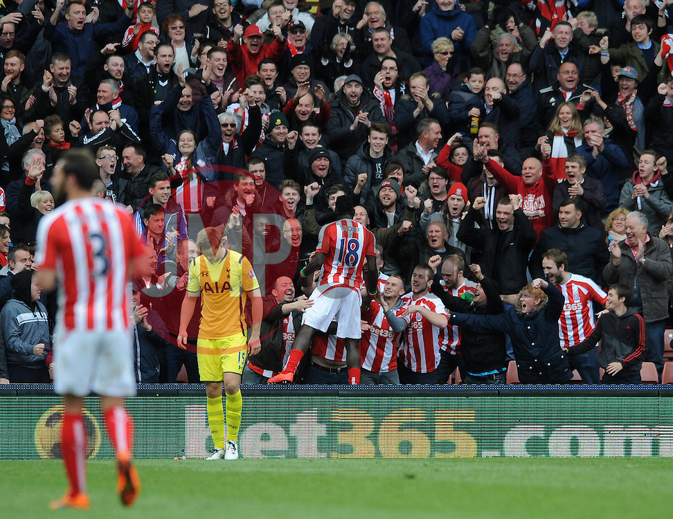 Stoke City's Mame Biram Diouf celebrates with the fans after scoring - Photo mandatory by-line: Dougie Allward/JMP - Mobile: 07966 386802 - 09/05/2015 - SPORT - Football - Stoke - Britannia Stadium<br />  - Stoke v Tottenham Hotspur - Barclays Premier League