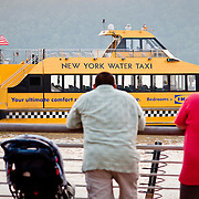 July 27, 2009 - Bronx, NY : West Side by Water.                                     The 7:27 New York Water Taxi arrives at the Yonkers Waterfront on Monday evening. The ferry service, proposed for Riverdale, would ferry passengers to southern Manhattan--a West-side alternative to Metro North, which routes commuters through the crowded Grand Central Terminal on the East side.