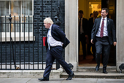 © Licensed to London News Pictures. 09/01/2018. London, UK. Foreign Secretary Boris Johnson (L) tucks his trousers in as he leaves 10 Downing Street after the first meeting of the Cabinet after Prime Minister Theresa May's reshuffle. Photo credit: Rob Pinney/LNP