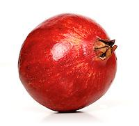 Studio shot of pomegranate fruit