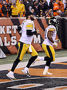 Pittsburgh Steelers quarterback Ben Roethlisberger (7) and Pittsburgh Steelers outside linebacker James Harrison (92) run onto the field for the NFL AFC Wild Card playoff football game against the Cincinnati Bengals on Saturday, Jan. 9, 2016 in Cincinnati. The Steelers won the game 18-16. (©Paul Anthony Spinelli)