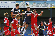 Picture by David Horn/Focus Images Ltd +44 7545 970036.18/08/2012.Mark Phillips of Southend United and Craig Lindfield of Accrington Stanley challenge for the ball during the npower League 2 match at Roots Hall, Southend.