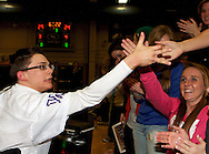 Wheat Ridge High School Junior Chris Reiman (white jersey) gives high fives to his classmates after the Arvada West Sparkles first performance at his high school.