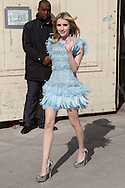 PARIS, FRANCE - MARCH 08:  Emma Roberts arrives at the Chanel Ready to Wear Autumn/Winter 2011/2012 show during Paris Fashion Week at Grand Palais on March 8, 2011 in Paris, France.  (Photo by Tony Barson/WireImage)