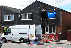 &copy; Licensed to London News Pictures. 08/08/2018<br /> Deptford, UK. A police evidence being gathered outside a property where 7 year Joel Urhie was killed in a suspicious house fire at Adolphus Street, Deptford.  <br /> Photo credit: Grant Falvey/LNP