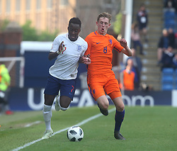 May 17, 2018 - United Kingdom - Arvin Appiah of England Under 17  under pressure from Wouter Burger of Netherlands Under 17 .during the UEFA Under-17 Championship Semi-Final match between England U17s against Netherlands U17s at Proact Stadium,  .Chesterfield FC, England on 17 May 2018. (Credit Image: © Kieran Galvin/NurPhoto via ZUMA Press)