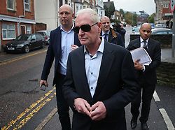 © Licensed to London News Pictures. 29/10/2015. Bournemouth, UK. Paul Gascoigne (C) leaves Bournemouth Magistrates Court after pleading guilty to harassment and assault charges. Photo credit: Peter Macdiarmid/LNP