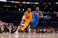 02 April 2013: Guard (24) Kobe Bryant of the Los Angeles Lakers drives to the basket while being guarded by (9) Jae Crowder of the Dallas Mavericks during the second half of the Lakers 101-81 victory over the Mavericks at the STAPLES Center in Los Angeles, CA.