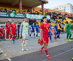 ORHEI, MOLDOVA - Friday, October 11, 2019: Wales' captain Jack Evans leads his side out before the UEFA Under-21 Championship Italy 2019 Qualifying Group 9 match between Moldova and Wales at the Orhei District Sports Complex. (Pic by Kunjan Malde/Propaganda)