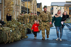 Pictured: Lance Corporal Lee Hill, his daughter Katie (three years old) and his wife Mandy holding Jessica (18 months)<br /> Glencouirse Barracks saw off 100 soldiers from 2 SCOTS today as they prepared to deploy to Iraq on a six month training and mentoring mission. The soldiers will deploy on what is known as Operation Shader, on a six month tour which is a different challenge from their previous combat roles in the country. Just over 100 personnel will depart from Glencorse, to join the advance party which is already in the country.<br /> <br /> Ger Harley | EEm 4 December 2017