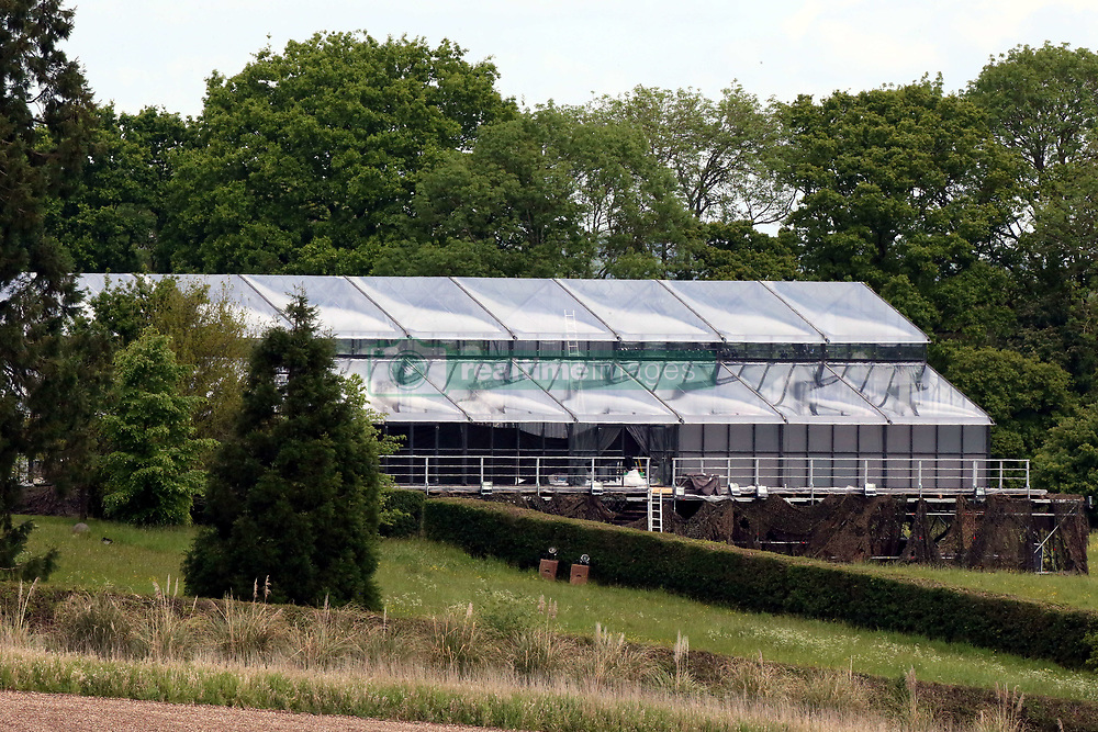 The finishing touches are being applied to the huge glass structure that has been erected for Pippa Middleton's wedding reception this weekend. The building, which is positioned inside the grounds of Michael and Carole MIddleton's country estate is visible from a public footpath.<br /><br />18 May 2017.<br /><br />Please byline: Vantagenews.com