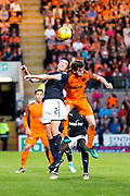 Dundee defender Cammy Kerr (#2) and Dundee United midfielder Sam Stanton (#12) contest the ball in the air during the Betfred Scottish Cup match between Dundee and Dundee United at Dens Park, Dundee, Scotland on 9 August 2017. Photo by Craig Doyle.