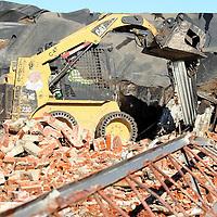 Adam Robison | BUY AT PHOTOS.DJOURNAL.COM<br /> Century Construction crews demolish the Block Corporation building, formally the Hancock Fabrics headquarters, on West Main Street in the Tupelo Thursday morning.