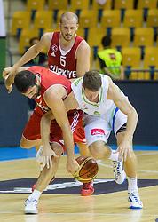 Onan Omer of Turkey vs Luka Lapornik of Slovenia during friendly match between National teams of Slovenia and Turkey for Eurobasket 2013 on August 4, 2013 in Arena Zlatorog, Celje, Slovenia. (Photo by Vid Ponikvar / Sportida.com)