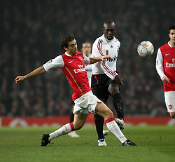 LONDON, ENGLAND - Wednesday, February 20, 2008 : Arsenal's Matthieu Flamini in action against AC Milan's Clarence Seedorf during the UEFA Champions 1st Knockout Round, 1st Leg match at The Emirates Stadium. (Photo by Chris Ratcliffe/Propaganda)