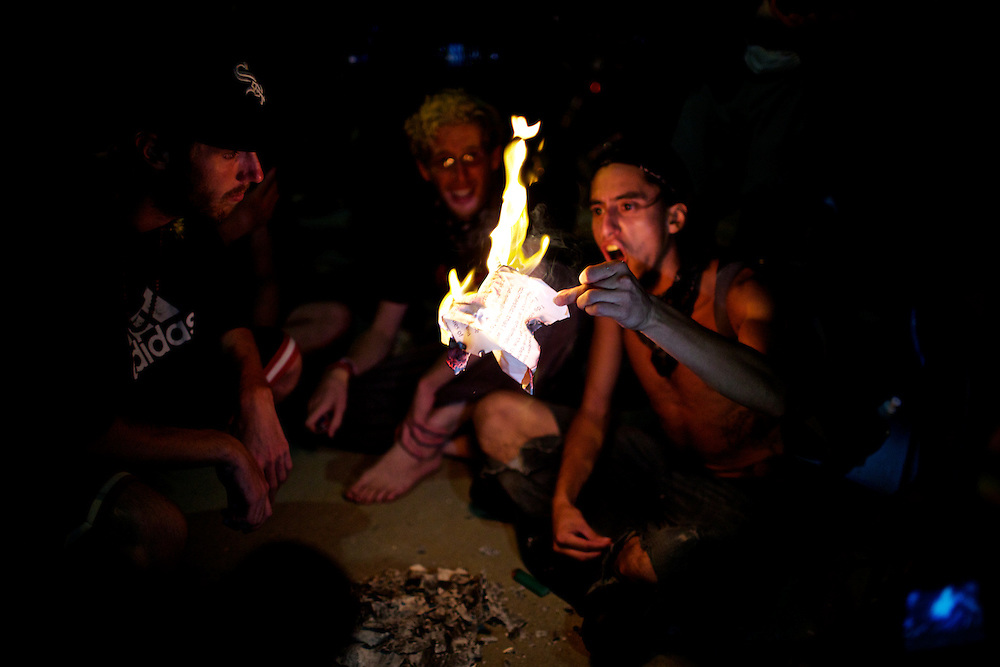 William Estrella, of the Occupy movement, burns a copy of the first amendment after being denied entry into the free speech zone in Charlotte, N.C. during the 2012 Democratic National Convention on Sept. 6, 2012.