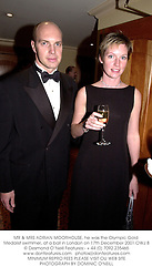 MR & MRS ADRIAN MOORHOUSE, he was the Olympic Gold Medalist swimmer, at a ball in London on 17th December 2001.	OWJ 8