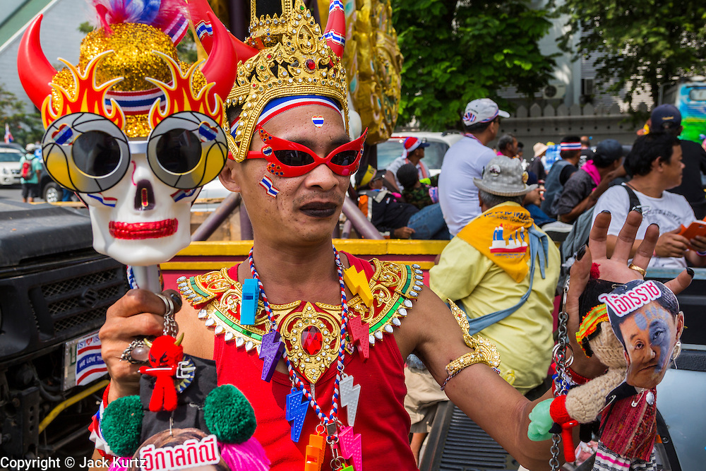 17 FEBRUARY 2014 - BANGKOK, THAILAND: An anti-government protestor dressed as an angel from Thai mythology on Ratchadamnoen Avenue. The anti-government protest movement, led by the People's Democratic Reform Committee and called Shutdown Bangkok has been going on for more than a month. The protest movement called, the People's Democratic Reform Committee (PDRC), wants to purge the current ruling party and its patrons in the Shinawatra family from Thai politics. The movement has consistently refused any dialogue or negotiations with the Pheu Thai ruling party. Over the weekend Thai police claimed to have taken the protest areas around Government House (the Prime Minister's office) away from protestors but on Monday protestors marched unimpeded to Government House and retook the area.   PHOTO BY JACK KURTZ