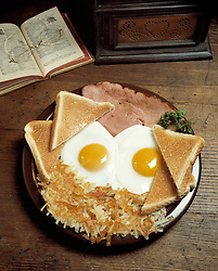 breakfast two fried eggs sunny side up slice ham hash brown potatos toast potatoes hearty breakfast Bon Appetit