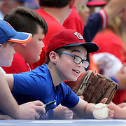 NEW YORK, NEW YORK - July 10: Young fans above the dugout attempt to get autographs from the Washington Nationals players during the Washington Nationals Vs New York Mets regular season MLB game at Citi Field on July 10, 2016 in New York City. (Photo by Tim Clayton/Corbis via Getty Images)