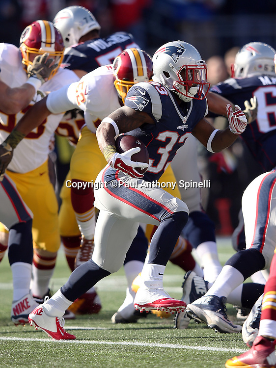 New England Patriots running back Dion Lewis (33) runs for a first quarter gain of 9 yards on the first play from scrimmage during the 2015 week 9 regular season NFL football game against the Washington Redskins on Sunday, Nov. 8, 2015 in Foxborough, Mass. The Patriots won the game 27-10. (©Paul Anthony Spinelli)