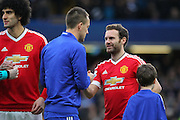Chelsea's John Terry shakes hands with Juan Mata of Manchester United during the Barclays Premier League match between Chelsea and Manchester United at Stamford Bridge, London, England on 7 February 2016. Photo by Phil Duncan.