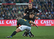 JOHANNESBURG, South Africa, 25 July 2015 : Richie McCaw (C) of the All Blacks prepares to take the hit by Jannie du Plessis of the Springboks during the Castle Lager Rugby Championship test match between SOUTH AFRICA and NEW ZEALAND at Emirates Airline Park in Johannesburg, South Africa on 25 July 2015. Bokke 20 - 27 All Blacks<br /> <br /> © Anton de Villiers / SASPA