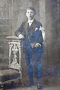 deteriorating studio portrait of an teenager boy standing
