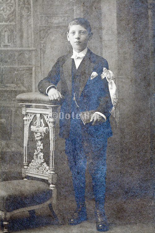 deteriorating studio portrait of an teenager boy standing