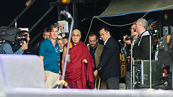 © Licensed to London News Pictures. 28/06/2015. Pilton, UK.  The Dalai Lama on the Glastonbury Festival Pyramid stage about to join the stage with Patti Smith  on Sunday Day 5.   Patti reads a poem to the Dalai Lama for his birthday, he joins her on stage, the audience sing him happy birthday, he blows candles out on his cake which he then cuts, before giving a speech to the audience.  This years headline acts include Kanye West, The Who and Florence and the Machine, the latter being upgraded in the bill to replace original headline act Foo Fighters.  Photo credit: Richard Isaac/LNP