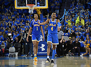 Feb 28, 2019; Los Angeles, CA, USA; UCLA Bruins guard Jaylen Hands (4) celebrates with center Moses Brown (1)after a 3-point basket in the final minute of overtime against the Southern California Trojans at Pauley Pavilion. UCLA defeated USC 93-88 in overtime.