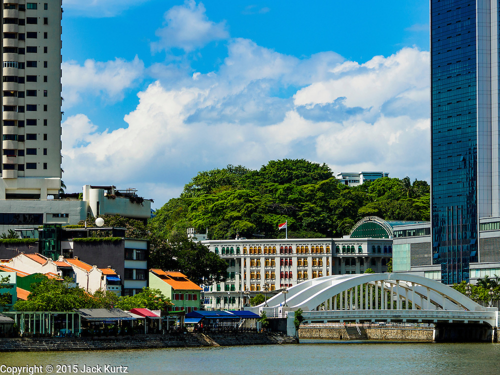 26 DECEMBER 2015 - SINGAPORE, SINGAPORE:  The North Bridge Street Bridge in Singapore with the Old Hill Street Police Station in the background. It is now an office building. Boat Quay, a dining and drinking pedestrian walk is on the left.   PHOTO BY JACK KURTZ
