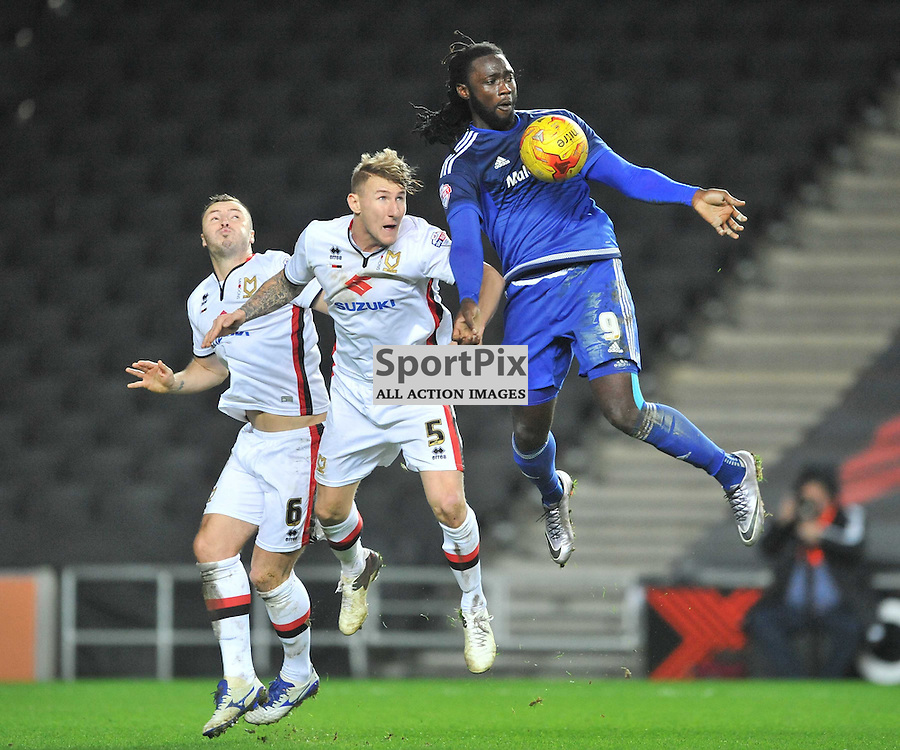 Cardiffs Kenwyne Jones battles with Dons Kyle McFadzean,  MK Dons v Cardiff, Sky Bet Championship, Saturday 26th December 2016