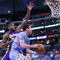 06 April 2014: Los Angeles Clippers guard J.J. Redick (4) goes for the reverse layup past Los Angeles Lakers forward Jordan Hill (27) during the Los Angeles Clippers 120-97 victory over the Los Angeles Lakers at the Staples Center, Los Angeles, California, USA.