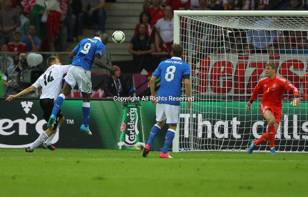 28.06.2012 Warsaw, Poland.  UEFA EURO 2012 SEMIFINAL   MARIO BALOTELLI (ITA) MARIO BALOTELLI (ITA)scores the first goal past Germany goalkeeper MANUEL NEUER