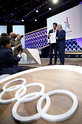 LIMA, Sept. 14, 2017  International Olympic Committee (IOC) President Thomas Bach (1st R) poses with Tony Estanguet, Co-chairman of Paris 2024, after sign the contract during the presentation and announcement ceremony of the 2024 and 2028 Summer Olympic Games at the 131st IOC session in Lima, Peru, on Sept. 13, 2017. The IOC makes historic decision by simultaneously awarding Olympic Games 2024 to Paris and 2028 to Los Angeles on wednesday. (Credit Image: © Li Ming/Xinhua via ZUMA Wire)