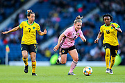 Kim Little (#8) of Scotland bursts forward with the ball pursued by Chinyelu Asher (#7) of Jamaica and Trudi Carter (#18) of Jamaica during the International Friendly match between Scotland Women and Jamaica Women at Hampden Park, Glasgow, United Kingdom on 28 May 2019.
