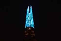 © Licensed to London News Pictures. 26/03/2020. London, UK. The London Shard is illuminated in blue this evening in recognition and appreciation of National Health Service (NHS) staff working in hospitals across the country during the ongoing COVID-19 coronavirus epidemic. Photo credit: Vickie Flores/LNP