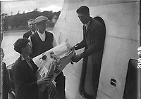 'Composite' Plane's Flight from Foynes men Loading Cargo on to the plane, 20 July 1938.<br /> (Part of the Independent Newspapers Ireland/NLI Collection)