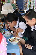 Office girls having Pho (noodle soup) for lunch.