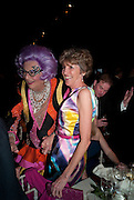 BARRY HUMPHRIES; LADY SPENCER-CHURCHILL, The Ormeley dinner in aid of the Ecology Trust and the Aspinall Foundation. Ormeley Lodge. Richmond. London. 29 April 2009