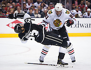 The Blackhawks' Marian Hossa knocks down the Kings' Dustin Brown during the third period of Chicago's 4-3 victory in Game 6 of the Western Conference Final of the 2014 NHL Stanley Cup Playoffs at Staples Center Friday night.