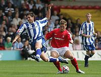 Photo: Paul Thomas.<br /> Nottingham Forest v Huddersfield. Coca Cola Championship.<br /> 06/08/2005.<br /> <br /> Kris Commons tackles Mark Hudson.