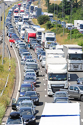 &copy; Licensed to London News Pictures. 23/07/2016<br /> <br /> M20 traffic near the Euro Tunnel Service Station at the back of a very very long queue into Dover, kent.<br /> Dover bound traffic ON THE  M20 in Kent at Junction 11A AND 12.  Queueing traffic because of very long delays at French border contol. <br /> <br /> <br /> (Byline:Grant Falvey/LNP)