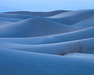 In the moments after sunset, the light softens to accentuate the subtle curves of the sand dunes, Death Valley National Park