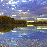 Experienced a katahum sunrise and morning earlier this year at Lake Cochituate in Wayland, MA. This urban lake borders the Boston suburbs Natick, Wayland and Framingham and is part of the Cochituate State Park in Massachusetts. There was still fall foliage colors to experience and the early morning light drew a beautiful light on this New England nature scenery, coloring it in fantastic colors and hues. I love experience the quietude that comes with an early morning photo shoot and really was in desperate need of it that morning. <br />