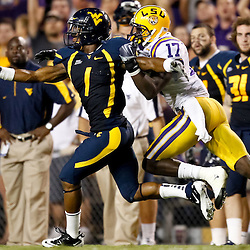 Sep 25, 2010; Baton Rouge, LA, USA; LSU Tigers cornerback Morris Claiborne (17) breaks up a pass intended for West Virginia Mountaineers wide receiver Tavon Austin (1) during the second half at Tiger Stadium. LSU defeated West Virginia 20-14.  Mandatory Credit: Derick E. Hingle