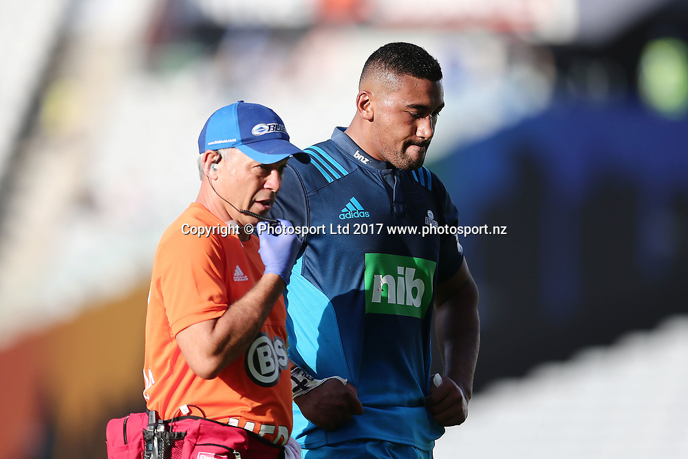 Jimmy Tupou of the Blues comes off the field with a possible injury. Super Rugby match, Blues v Force at Eden Park, Auckland, New Zealand. 1 April 2017 © Copyright Photo: Anthony Au-Yeung / www.photosport.nz