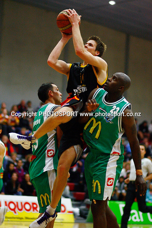 Pistons' Thomas Abercrombie draws a foul from Jets Richard Jeter on his way to the basket. Bartercard NBL, Waikato Pistons v Manawatu Jets, Hamilton Boys High School, Hamilton, New Zealand. Saturday 1st May 2010. Photo: Anthony Au-Yeung/PHOTOSPORT