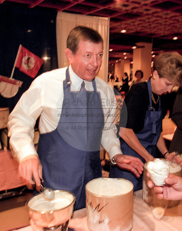Conservative Republican Senator John Ashcroft serves ice cream to supporters at the Road to Victory event at the Christian Coalition Conference September 19, 1998 in Washington, DC.